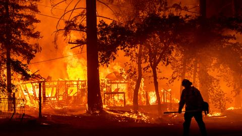 Two California wildfires merge, sparking more evacuations