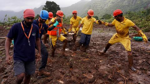 Death toll rises from India torrential rains, scores trapped in landslides
