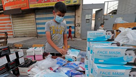 Iraq records over 12,000 infections in new daily high – latest updates