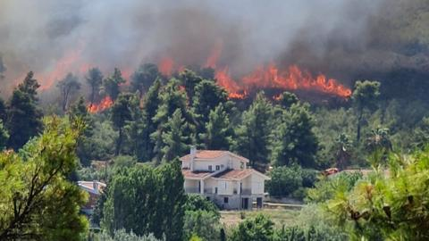 'Out of control' Greek fire threatens Athens suburbs