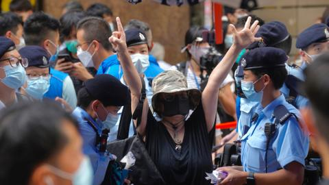 Hong Kong silenced: National security law and loyalty tests mute dissent