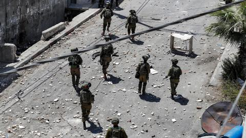 Israeli troops fire at Palestinians protesting boy's killing, one dead