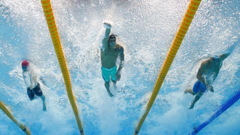 US swimmers Dressel, Ledecky win gold again at Olympic pool