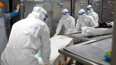 Thai hospital uses containers to store bodies – latest updates