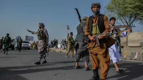 Government forces combat Taliban incursions on key Afghan cities