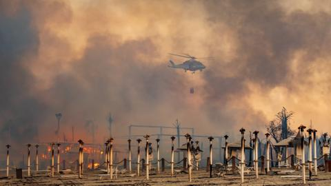 Thousands evacuate as wildfires rage across southern Europe