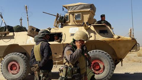 Afghan forces battle to defend major cities from Taliban offensive