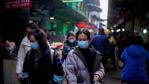 China orders mass testing after virus returns to Wuhan – latest updates
