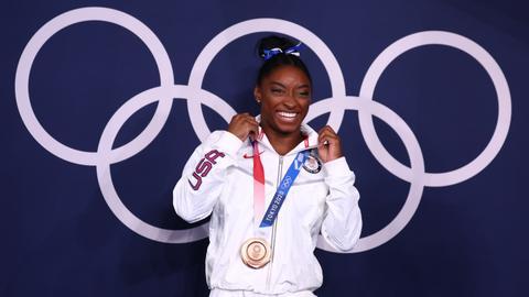 Biles wins bronze as she makes triumphant return to Olympics