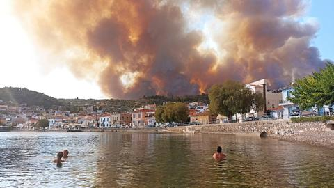 Thousands of Greeks flee homes north of Athens as fires rage amid heat wave