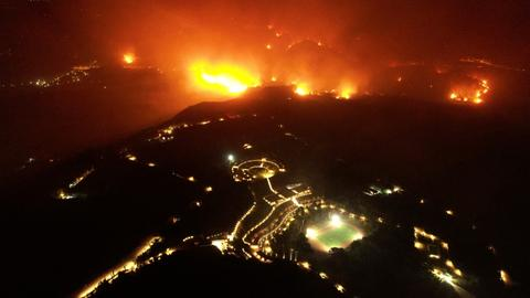Greece 'waging battle of titans' as flames destroy 150 homes