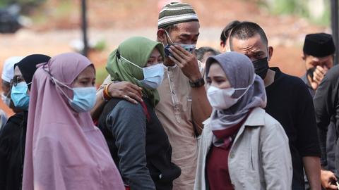 Indonesia's virus death toll tops 100,000 – latest updates