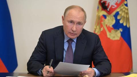 Putin says dozens in Kremlin inner circle have Covid – latest updates