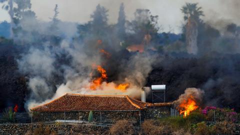 Lava destroys dozens of Canary Island homes as volcano erupts