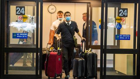 US to end travel bans for Covid vaccinated passengers – latest updates