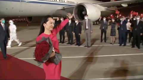 Huawei executive Wanzhou arrives in China after being freed in Canada