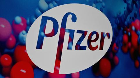 Pfizer begins large trial to test its anti-Covid pill – latest updates