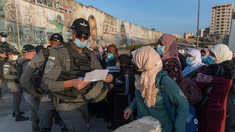 Israel legalises 4,000 Palestinians, but many still feel 'imprisoned'