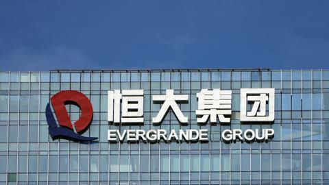 Property giant Evergrande pays overdue interest on offshore bond
