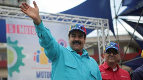 Maduro threatens to seize factories, orders military drills