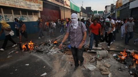 Violence continues in Venezuela as armed squad kills 11