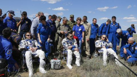 Astronauts return to Earth after six months in space
