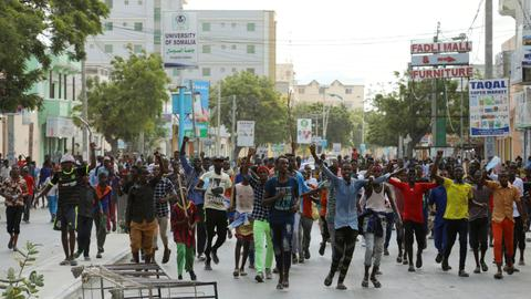 Thousands take to streets of Somalia to protest deadly truck bombings