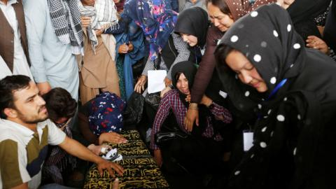 Afghans question security measures as families bury the dead