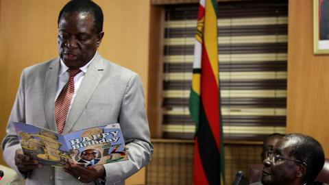 Zimbabwe's fired vice president issues challenge to Mugabes