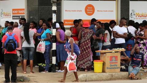 Facing rocketing inflation, Zimbabweans turn to bitcoin