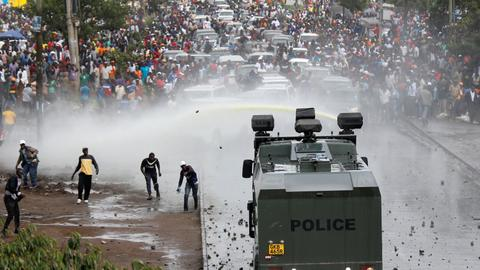 Kenyan police fire in air to disperse supporters welcoming Odinga