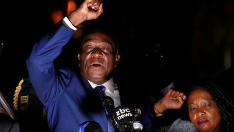 Zimbabwe's incoming leader Mnangagwa returns home to cheers