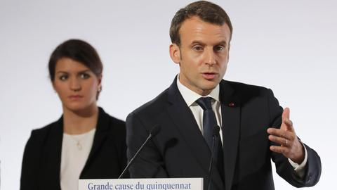 France's Macron unveils plan to curb violence against women