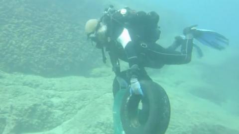 Scuba divers clean up rubbish off the coast of Lebanon