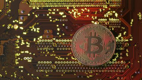Bitcoin tops $10,000