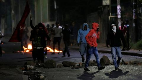 Vote count in resumes in Honduras amid mass protest