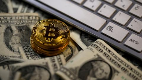 Bitcoin soars then falls back as concerns mount