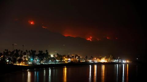 Firefighters defend homes as California wildfires rage on