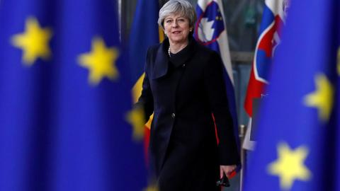 Britain's May says on course to deliver Brexit