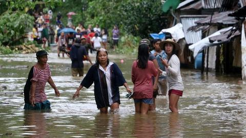 Three dead, thousands flee as storm pounds Philippines