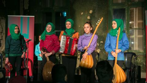 Music brings solace to some refugees in Lebanon