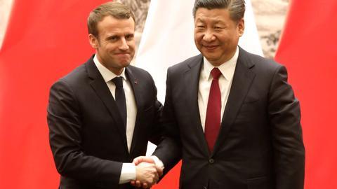 Macron urges China to open market wider