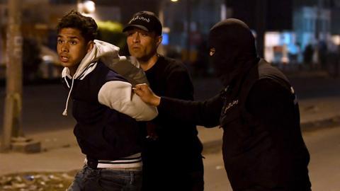 Tunisia makes more arrests as violent unrest grows