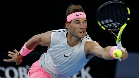 Nadal returns to his sleeveless roots – and pain-free play