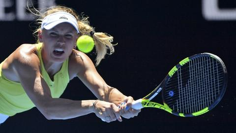 Nadal into third round as Wozniacki saves two match points to advance