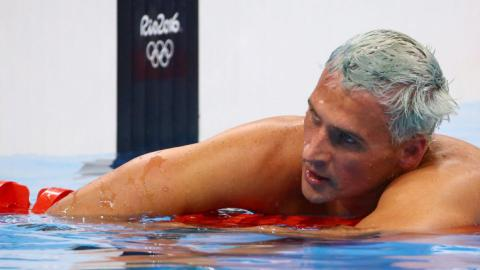 Ryan Lochte charged by Brazil over false robbery claim