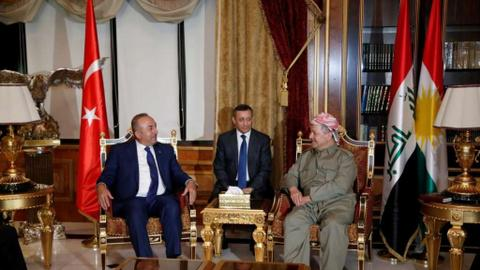 Turkish FM visits Iraq, hoping to mediate between Erbil and Baghdad