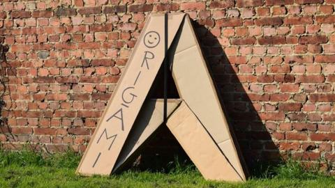 Belgian designer distributes origami-style cardboard tents to homeless