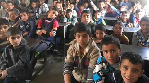 Mosul's children return to school amid constant reminder of war