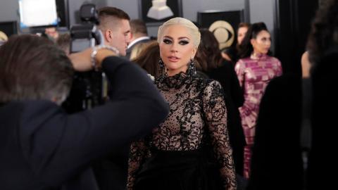 Gaga among stars wearing white roses on Grammys red carpet